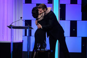 Honoree Sue Kroll (L) accepts the Sid Grauman Award from actor Bradley Cooper onstage at the 30th Annual American Cinematheque Awards Gala at The Beverly Hilton Hotel on October 14, 2016 in Beverly Hills, California.