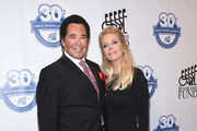 Wayne Newton and Kathleen McCrone attend the 30th Annual Great Sports Legends Dinner to benefit The Buoniconti Fund to Cure Paralysis at The Waldorf Astoria on October 6, 2015 in New York City.