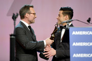 Rami Malek (R) accepts the Breakthrough Performance Award from Christian Slater onstage at the 30th Annual Palm Springs International Film Festival Film Awards Gala at Palm Springs Convention Center on January 3, 2019 in Palm Springs, California.