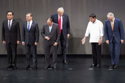 (L-R) Thailand's Prime Minister Prayut Chan-O-Cha, Russian Prime Minister Dmitry Medvedev, Vietnam's Prime Minister Nguyen Xuan Phuc, US President Donald Trump, Philippine President Rodrigo Duterte and Australia Prime Minister Malcolm Turnbull arrive for the family photo during the 31st Association of South East Asian Nations (ASEAN) Summit in Manila on November 13, 2017. .World leaders are in the Philippines' capital for two days of summits.  / AFP PHOTO / JIM WATSON