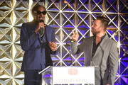 Snoop Dogg (L) and Nick Swisher speak onstage during the 34th Annual Cedars-Sinai Sports Spectacular at The Compound on July 15, 2019 in Inglewood, California.