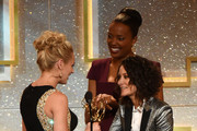 (L-R) Actress Hunter King accepts Outstanding Younger Actress in a Drama Series for 'The Young and the Restless' from actresses Aisha Tyler and Sara Gilbert onstage during The 41st Annual Daytime Emmy Awards at The Beverly Hilton Hotel on June 22, 2014 in Beverly Hills, California.