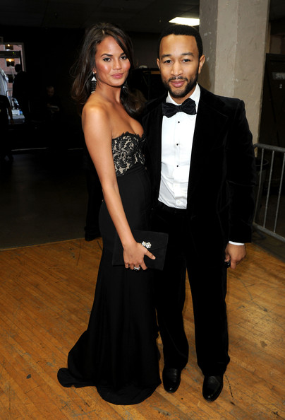Singer John Legend (R) and model Christine Teigen  backstage during the 41st NAACP Image awards held at The Shrine Auditorium on February 26, 2010 in Los Angeles, California.