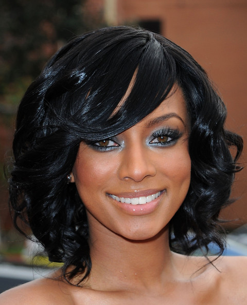Keri looked smokin' hot in her ruffled black dress she topped it off ...