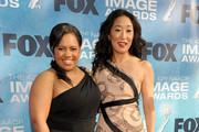 Actresses Chandra Wilson (L) and Sandra Oh arrive at the 42nd NAACP Image Awards held at The Shrine Auditorium on March 4, 2011 in Los Angeles, California.