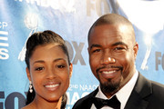Dr. Courtney White and actor Michael Jai White arrive at the 42nd NAACP Image Awards held at The Shrine Auditorium on March 4, 2011 in Los Angeles, California.