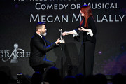 Nick Offerman (L) and Megan Mullally speak onstage at the 43rd Annual Gracie Awards at the Beverly Wilshire Four Seasons Hotel on May 22, 2018 in Beverly Hills, California.
