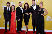 (L-R) Lady Antebellum members Dave Haywood with wife Kelli Cashiola, Hillary Scott (third from right) with husband  Chris Tyrrell (third from left), and Charles Kelley (second from right) with wife Cassie McConnell attend the 46th annual CMA Awards at the Bridgestone Arena on November 1, 2012 in Nashville, Tennessee.