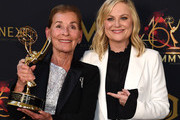 Judge Judy (L) poses with the Daytime Emmy Award for Outstanding Legal/Courtroom Program with Amy Poehler during the 46th annual Daytime Emmy Awards at Pasadena Civic Center on May 05, 2019 in Pasadena, California.