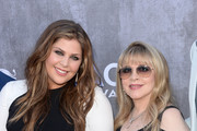 Singers Hillary Scott of Lady Antebellum (L) and Stevie Nicks attend the 49th Annual Academy Of Country Music Awards at the MGM Grand Garden Arena on April 6, 2014 in Las Vegas, Nevada.