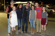 Singer Lee Brice (C) with guests Boston Gilbert, Ginger Gilbert Ravella, Bella Gilbert Ravella, Annalise Gilbert Ravella, Aspen Gilbert Ravella, and Greyson Ravella attend the 4th ACM Party for a Cause Festival at the Las Vegas Festival Grounds on April 2, 2016 in Las Vegas, Nevada.
