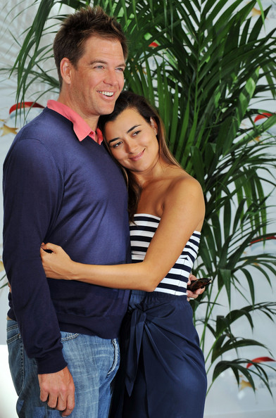 Actors Michael Weatherly and Cote De Pablo pose during a photocall for
