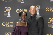 Lupita Nyong'o (L) and Vin Diesel attend the 50th NAACP Image Awards at Dolby Theatre on March 30, 2019 in Hollywood, California.