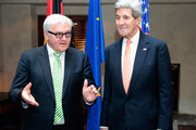 Frank-Walter Steinmeier (L), German minister of foreign affairs and John Kerry, US secretary of state, pose ahead of a bilateral meeting at the 51st Munich Security Conference (MSC) on February 7, 2015 in Munich, Germany. Foreign ministers and defense ministers from countries across the globe are meeting to discuss current global security issues, in particular the crisis in eastern Ukraine, the spread of ISIS in Syria and Iraq and the large-scale movement and plight of refugees.
