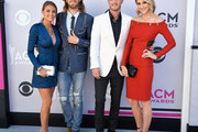 (L-R) Brittney Marie Cole, recording artists Brian Kelley and Tyler Hubbard of music group Florida Georgia Line, and Hayley Stommel attend the 52nd Academy Of Country Music Awards at Toshiba Plaza on April 2, 2017 in Las Vegas, Nevada.