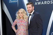 (FOR EDITORIAL USE ONLY) Carrie Underwood and  Mike Fisher attend the 52nd annual CMA Awards at the Bridgestone Arena on November 14, 2018 in Nashville, Tennessee.