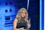 (FOR EDITORIAL USE ONLY) Singer Carrie Underwood accepts award onstage during the 52nd annual CMA Awards at the Bridgestone Arena on November 14, 2018 in Nashville, Tennessee.