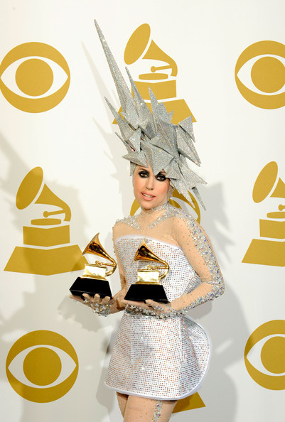 Singer Lady Gaga poses with Electronic/Dance Album award for 'The Fame' and Dance Recording award for 'Poker Face' in the press room during the 52nd Annual GRAMMY Awards held at Staples Center on January 31, 2010 in Los Angeles, California.