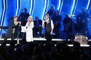 (FOR EDITORIAL USE ONLY) Joel Smallbone and Luke Smallbone of For King & Country and Dolly Parton (M) perform onstage during the 53rd annual CMA Awards at the Music City Center on November 13, 2019 in Nashville, Tennessee.