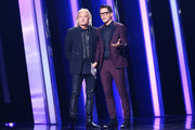 (FOR EDITORIAL USE ONLY) Joe Walsh and Bobby Bones speak onstage during the 53rd annual CMA Awards at the Bridgestone Arena on November 13, 2019 in Nashville, Tennessee.