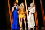 (FOR EDITORIAL USE ONLY) (L-R) Reba McEntire, Carrie Underwood, and Dolly Parton perform onstage during the 53rd annual CMA Awards at the Music City Center on November 13, 2019 in Nashville, Tennessee.