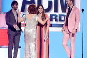 Host Reba McEntire (2nd from L, fashion detail) greets (from L) Dave Haywood, Hillary Scott, and Charles Kelley of Lady Antebellum onstage during the 54th Academy Of Country Music Awards at MGM Grand Hotel & Casino on April 07, 2019 in Las Vegas, Nevada.