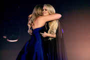 (L-R) Lauren Alaina and Carrie Underwood perform onstage during the 54th Academy Of Country Music Awards at MGM Grand Garden Arena on April 07, 2019 in Las Vegas, Nevada.