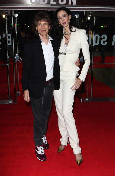 Mick Jagger of the Rolling Stones and L'Wren Scott attend the Premiere of 'Crossfire Hurricane' during the 56th BFI London Film Festival at Odeon Leicester Square on October 18, 2012 in London, England.