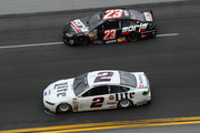Alex Bowman, driver of the #23 Dr. Pepper Toyota, races Brad Keselowski, driver of the #2 Miller Lite Ford, during the NASCAR Sprint Cup Series Daytona 500 at Daytona International Speedway on February 23, 2014 in Daytona Beach, Florida.