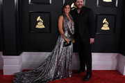 Chris Young (R) and Cassadee Pope arrive for the 59th Grammy Awards pre-telecast on February 12, 2017, in Los Angeles, California.  / AFP / Mark RALSTON