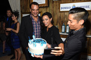 Evan Hainey (L) and Rosario Dawson (C) attend the 5th Annual Bombay Sapphire Artisan Series Finale at Tent at Soho Beach House on December 4, 2014 in Miami, Florida.