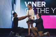 (L-R) Internet personality Andrew B. Bachelor, aka King Bach, actress Kat Graham and internet personality Philip DeFranco speak on stage VH1's 5th Annual Streamy Awards at the Hollywood Palladium on Thursday, September 17, 2015 in Los Angeles, California.