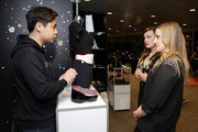 Actors Abby Mueller (C) and Kara Lindsay (R) attend the GRAMMY Gift Lounge during the 60th Annual GRAMMY Awards at Madison Square Garden on January 25, 2018 in New York City.