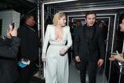 Meghan Trainor (L) and Daryl Sabara backstage during the 61st Annual GRAMMY Awards at Staples Center on February 10, 2019 in Los Angeles, California.