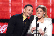 Kane Brown (L) and Meghan Trainor speak onstage during the 61st Annual GRAMMY Awards at Staples Center on February 10, 2019 in Los Angeles, California.