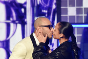 Swizz Beatz (L) kisses Alicia Keys onstage during the 61st Annual GRAMMY Awards at Staples Center on February 10, 2019 in Los Angeles, California.