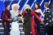 Billie Eilish (4th L) and and Finneas O'Connell (R) accept the Song of the Year award for 'Bad Guy' from (from L) Smokey Robinson and music group Little Big Town's Kimberly Schlapman and Philip Sweet onstage during the 62nd Annual GRAMMY Awards at STAPLES Center on January 26, 2020 in Los Angeles, California. (Photo by Kevin Winter/Getty Images for The Recording Academy )Philip Sweet