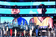 Images for the late Nipsey Hussle and Kobe Bryant are projected onto a screen while YG, John Legend, Kirk Franklin, DJ Khaled, Meek Mill, and Roddy Ricch perform onstage during the 62nd Annual GRAMMY Awards at STAPLES Center on January 26, 2020 in Los Angeles, California.