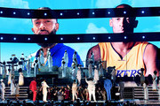 Images for the late Nipsey Hussle and Kobe Bryant are projected onto a screen while (L-R) YG, John Legend, Kirk Franklin, DJ Khaled, Meek Mill, and Roddy Ricch perform onstage during the 62nd Annual GRAMMY Awards at STAPLES Center on January 26, 2020 in Los Angeles, California.