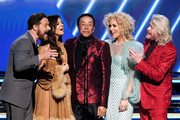Smokey Robinson (C) and (from L) Jimi Westbrook, Karen Fairchild, Kimberly Schlapman, and Philip Sweet of music group Little Big Town speak onstage during the 62nd Annual GRAMMY Awards at STAPLES Center on January 26, 2020 in Los Angeles, California.