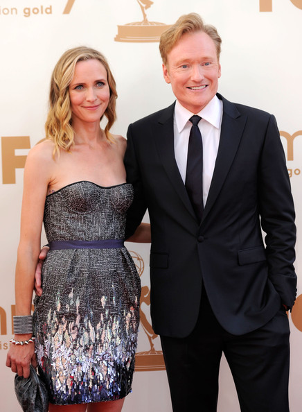 Comedian Conan O'Brien (R) and wife Liza Powel arrive at the 63rd Annual Primetime Emmy Awards held at Nokia Theatre L.A. LIVE on September 18, 2011 in Los Angeles, California.