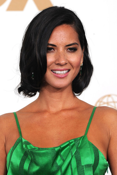 Actress Olivia Munn poses in the press room during the 63rd Annual Primetime Emmy Awards held at Nokia Theatre L.A. LIVE on September 18, 2011 in Los Angeles, California.