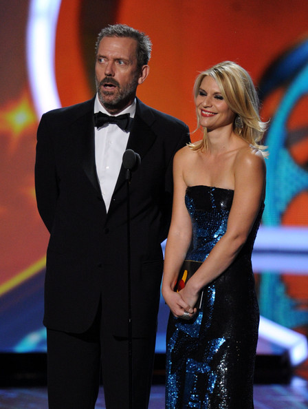 Actors Hugh Laurie (L) and Claire Danes speak onstage during the 63rd Annual Primetime Emmy Awards held at Nokia Theatre L.A. LIVE on September 18, 2011 in Los Angeles, California.