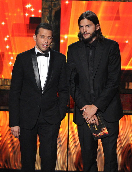 Actors Jon Cryer (L) and Ashton Kutcher speak onstage during the 63rd Annual Primetime Emmy Awards held at Nokia Theatre L.A. LIVE on September 18, 2011 in Los Angeles, California.