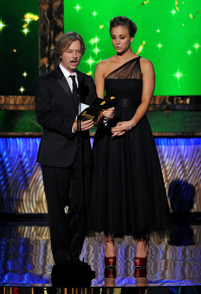 Actors David Spade (L) and Kaley Cuoco speak onstage during the 63rd Annual Primetime Emmy Awards held at Nokia Theatre L.A. LIVE on September 18, 2011 in Los Angeles, California.