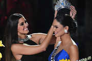 Miss Universe 2014 Paulina Vega (L) crowns Miss Philippines 2015, Pia Alonzo Wurtzbach, the new Miss Universe after host Steve Harvey mistakenly named Miss Colombia 2015, Ariadna Gutierrez (not pictured), the winner instead of Wurtzbach during the 2015 Miss Universe Pageant at The Axis at Planet Hollywood Resort & Casino on December 20, 2015 in Las Vegas, Nevada.