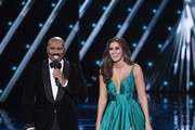 Host Steve Harvey (L) talks with Miss Universe 2014 Paulina Vega during the 2015 Miss Universe Pageant at The Axis at Planet Hollywood Resort & Casino on December 20, 2015 in Las Vegas, Nevada.