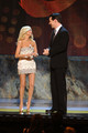 Actors Kristen Chenoweth and Sean Hayes onstage during the 64th Annual Tony Awards at Radio City Music Hall on June 13, 2010 in New York City.