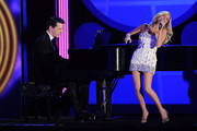 Actors Sean Hayes and Kristen Chenoweth performs onstage during the 64th Annual Tony Awards at Radio City Music Hall on June 13, 2010 in New York City.