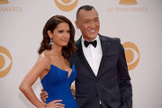 Elle Magazine's Joe Zee and guest arrive at the 65th Annual Primetime Emmy Awards held at Nokia Theatre L.A. Live on September 22, 2013 in Los Angeles, California.